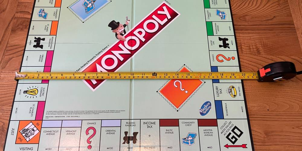 Monopoly board with tape measure